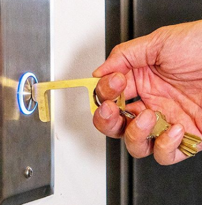 "This Brass ""Hygiene Hand"" Tool Acts As A Substitute For Human Hands On Public Surfaces"
