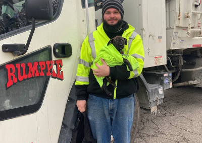 Garbage Truck Driver Saves Puppy Discarded In BackPack And Adopts Her